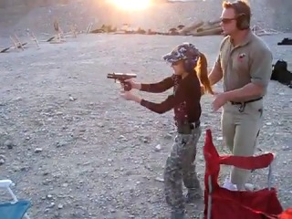 11 Year-Old Girl At The Shooting Range